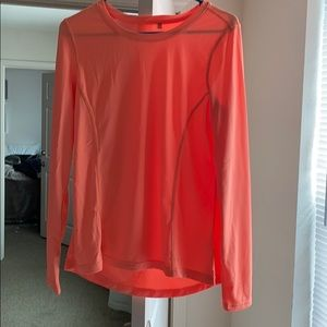 Long sleeve orange workout shirt.